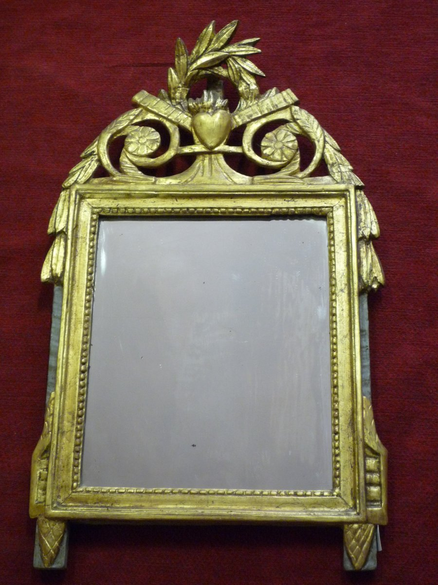 Late 18th Century Carved And Gilded Wood Mirror Topped With A Pediment