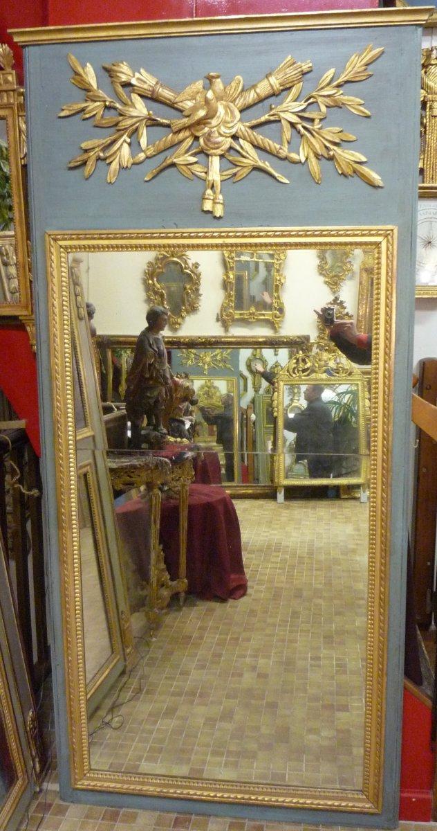 Trumeau d'époque Louis XVI en bois sculpté et doré.