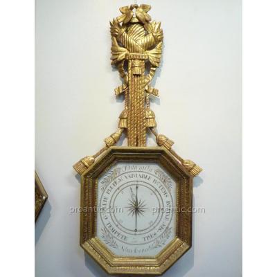 Baromètre en bois doré d'époque Empire XIXème