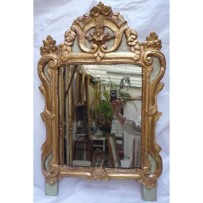 Miroir d'époque Louis XVI en bois sculpté et doré