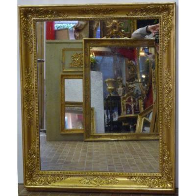 Miroir d'époque Empire en bois doré