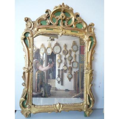 Miroir d'époque Louis XV en bois sculpté et doré