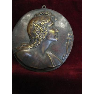 Modernist Bronze Medallion Representing A Woman With Poppies As An Allegory Of The Sommei