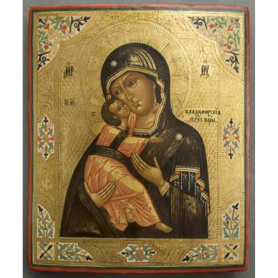 Icon representing the virgin of Vladimir.<br /> Russia in the Moscow region, and dates from the late 19th century.<br /> The virgin holds Christ tenderly with her right arm, her cheeks touch each other affectionately.<br /> Gold-plated and painted back engravings. Cypress wood.<br /> <br /> Paifait state of condition!<br /> &nbsp;