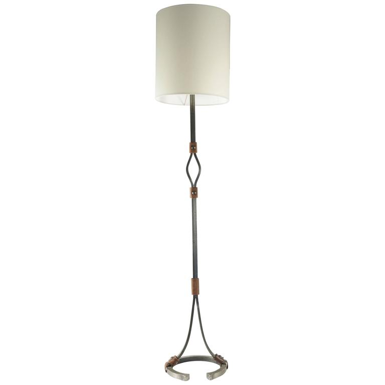 Floor Lamp From The 1960's En Wrought Iron And Leather, The Bottom Formed As A Horse Shoe.
