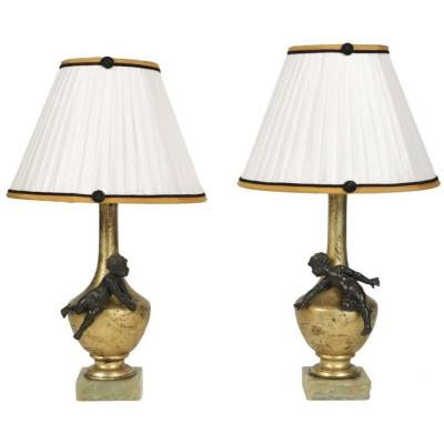Pair Of Exceptional Matching Napoleon III Lamps From The 19th Century Of Two Putti