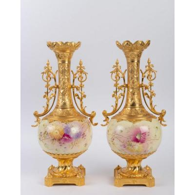 Pair of painted porcelain vases representing floral scenes, and set with gilded bronzes; In very good shape ; XIX th century, Napoleon III.
