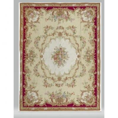 Aubusson-style needle rug with floral medallion pattern and flower garlands on a beige background. In the taste of the Savonnerie manufacture.Size: 360 X 270 cm.