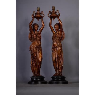 Pair Of Woman Draped In The Ancient Regulates Forming Oil Lamps In Regulates