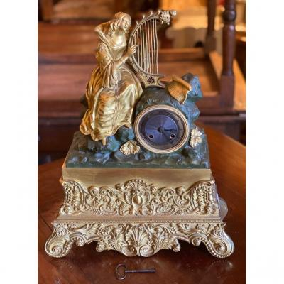 Charles X Clock In Gilded And Oxidized Bronze