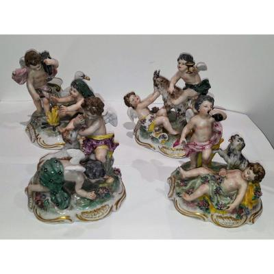 Group Of Painted Porcelain Figurines
