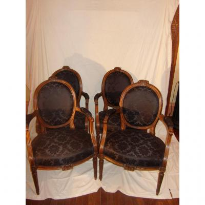 Suite Of Four Armchairs.