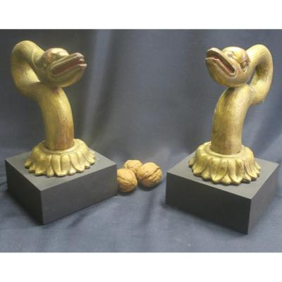 Two Goblin Heads In Golden Wood