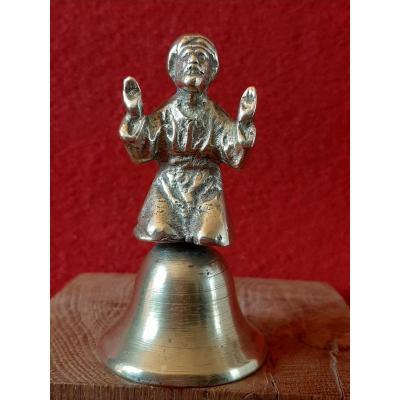 Table Bell Man In Turban Praying.