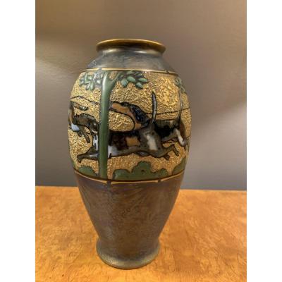 Porcelain Dog Race Vase From Turn Teplitz.