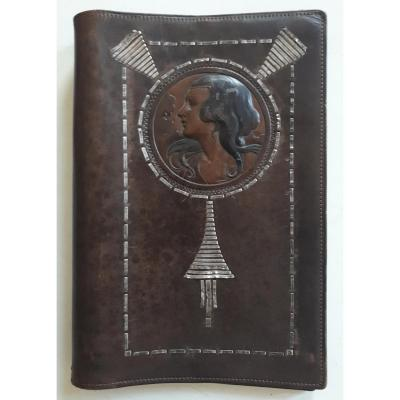 Liseuse couvre-livre en cuir repoussé décor femme 1900 Art Nouveau