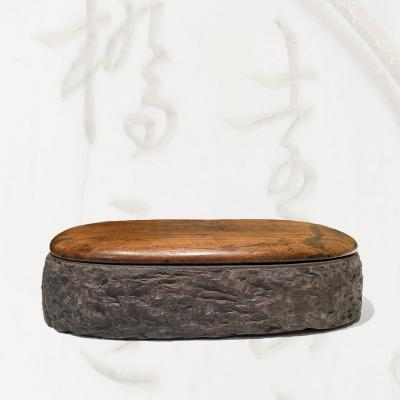 Beautiful Chinese ink stone carved from a traditional duan stone. &nbsp;It has retained its original hongmu cover.<br />