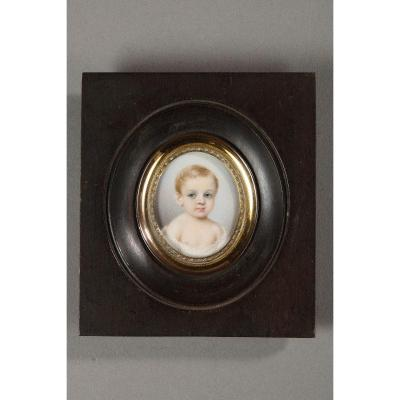 A Mid-19th Century Portrait Of A Child On Ivory.