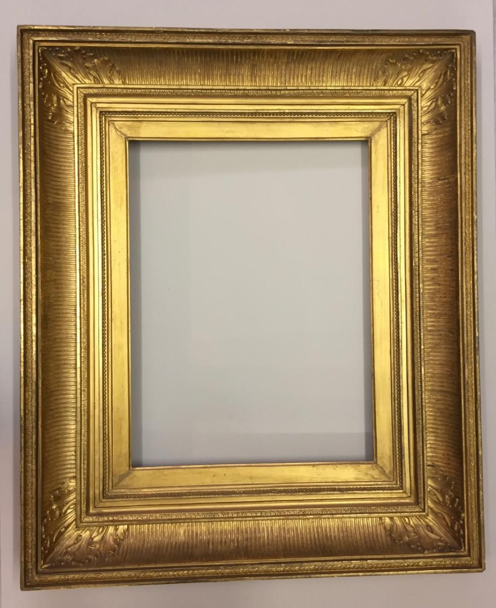 Frame With Wooden Canes And Golden Stucco