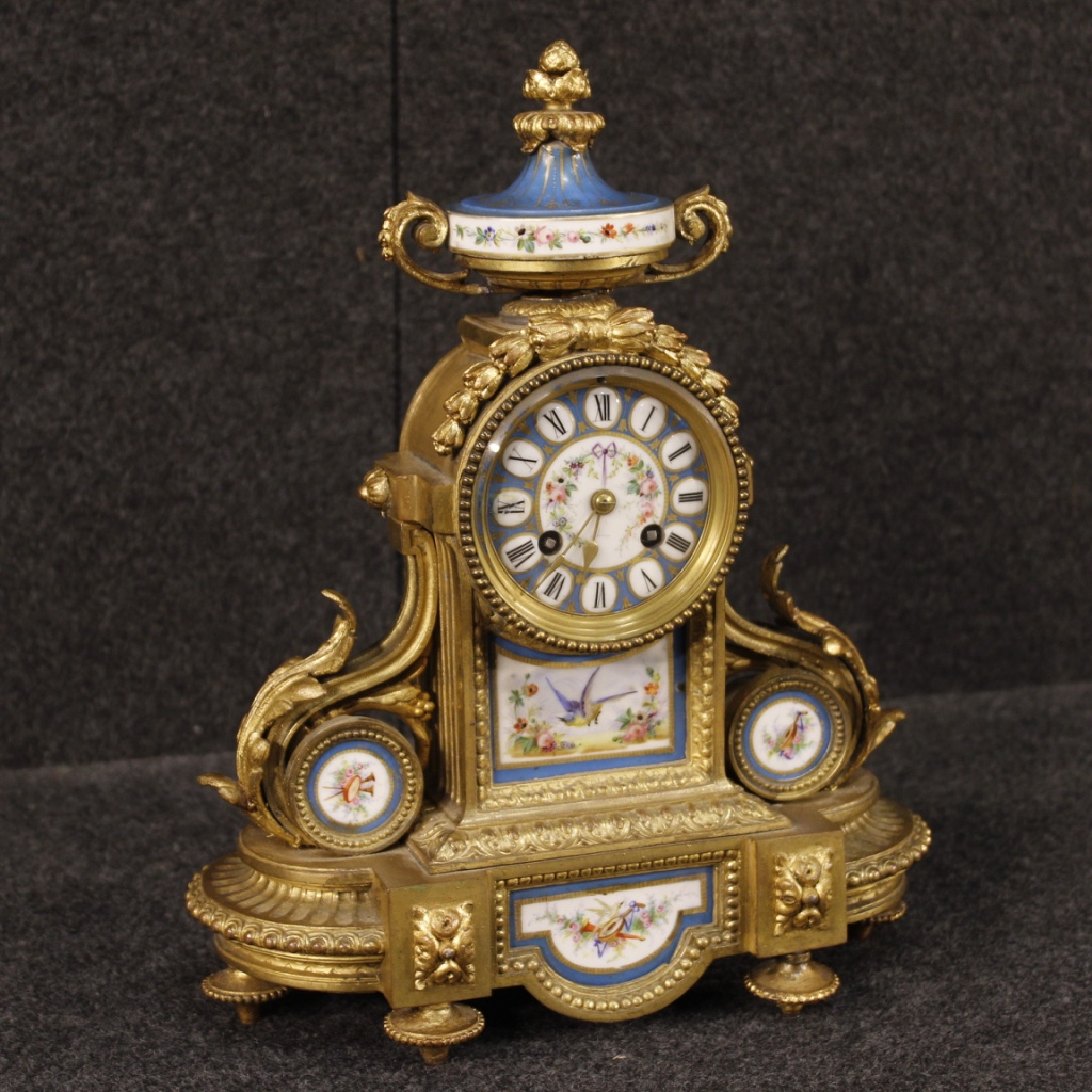 French Clock In Gilded Bronze And Brass With Painted Ceramic