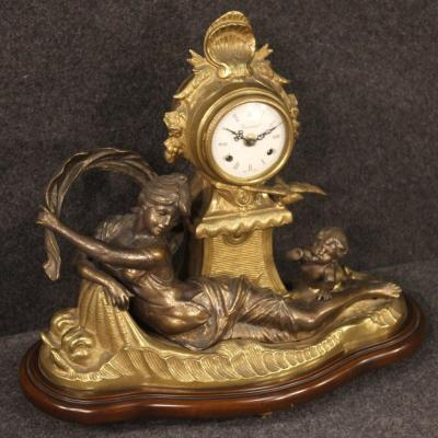 French Clock In Bronze And Gilded Antimony