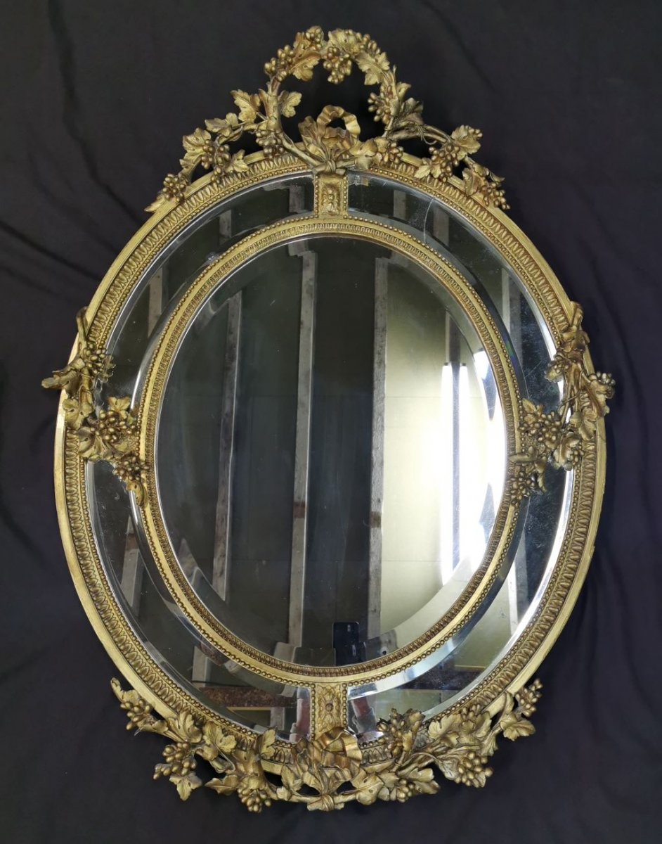 Oval Golden Mirror With Parecloses From Napoleon III Period. Middle XIXth