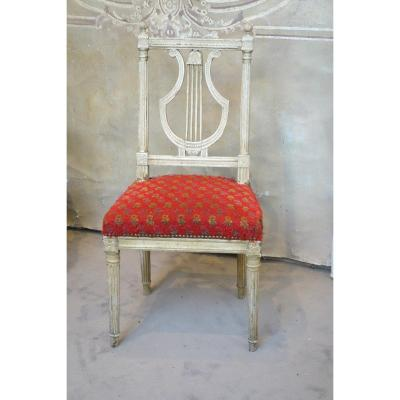 Charming chair, Lyre folder, cream plated ,fluted feet,in very good shape reliable and solid, however the tapestry is very damaged.<br /> end of 19th century
