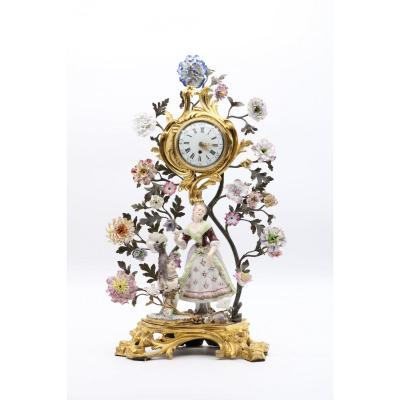 An Exceptional Watch Holder Representing A Shepherdess Accompanied By A Porcelain Cherub D