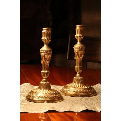 Pair Of Candlesticks In Gilt Bronze And Chiseled