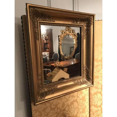 Petit miroir d'époque Empire bois doré