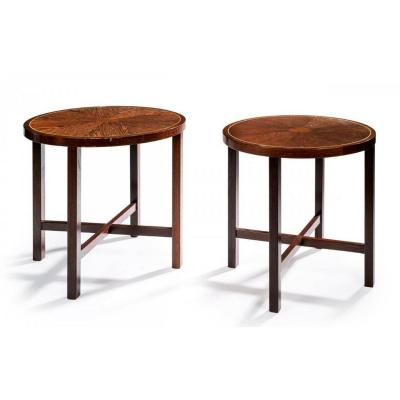 pair of tables in wenge veneer and silver nets designed to decorate the shop of the Danish goldsmith Georg Jensen.