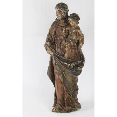 """""""Saint Joseph portant l'Enfant Jésus""""  grand groupe en bois sculpté du XVIIe siècle"""