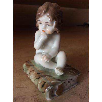 Polychrome Porcelain By Müller Representing A Little Girl Sitting On A Book.