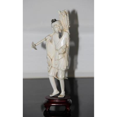 Okimono In Ivory Representing An Old Fisherman