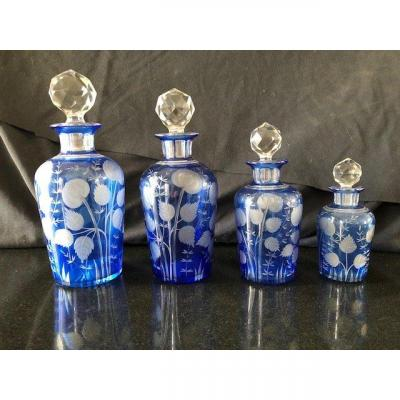 Series Of Four Baccarat Engraved Crystal Toilet Bottles