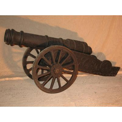 Cast Iron Cannon Decorated With Flames And Lion Heads