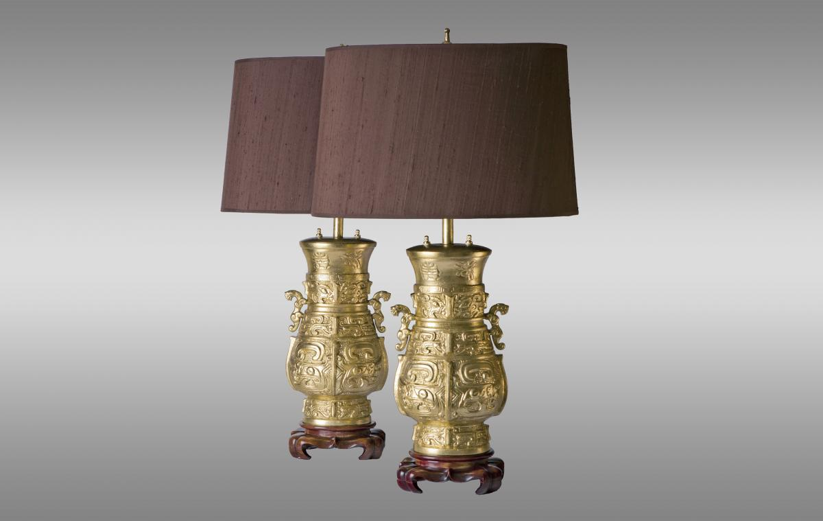 Gilded Bronze Vases Mounted In Lamps On Wooden Pedestals.