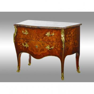 A Louis XV Period Commode In Marquetry From Different Woods