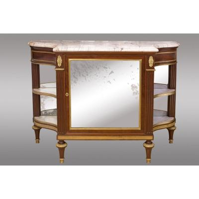 Commode Serving The End Of The Loius XVl Period. Made In Mahogany, Decorated With Gilded Bronzes.