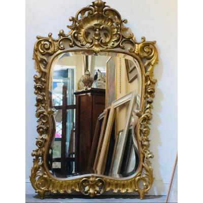 Beveled Mirror In Carved And Gilded Wood