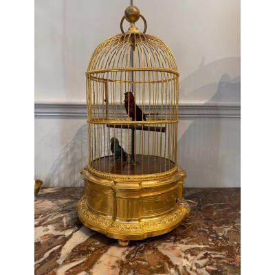 Belle Et Rare Cage à deux oiseaux chanteur Signé Bontems  . Base en Bronze doré.