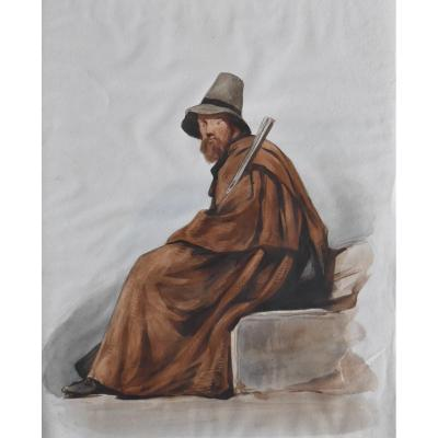 French school 19th century,&nbsp;<br /> An italian bandit, 1864,&nbsp;<br /> watercolor on paper<br /> On the reverse of the sheet (now under the back of the frame) an annotation, &quot;Rome 1864&quot;<br /> 25,5 &nbsp;x 21.5 cm (view)&nbsp;<br /> in good condition, slight undulations of the paper as visible on the photographs<br /> In a modern frame: 39 x 35 cm<br /> <br /> This charming watercolor has been attributed to Antoine-Alphonse Montfort (1802-1884), who was a painter and traveler, known for his orientalist paintings and genre scenes.<br /> As this artist, many european painters from France and northern Europe were interested by the romantic exotism of southern Europe, Greece and Italy mainly and North Africa, where they used to draw and paint characters, such as brigands or craftsmen.<br /> &nbsp;