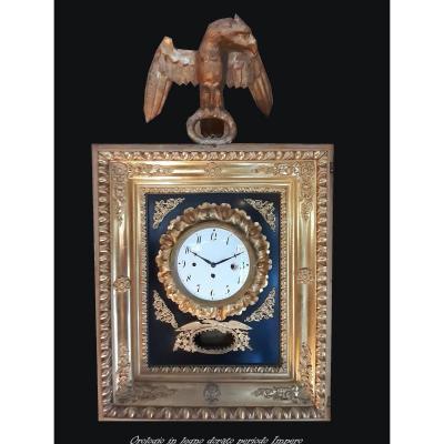 Pendule italienne ancienne en bois doré et laqué d'époque Empire