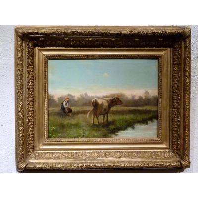 Jeune vacher et sa vache dans la Dombes