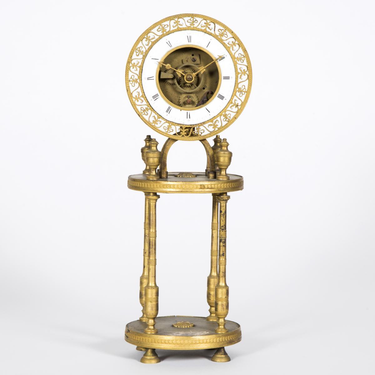 Pendule squelette à colonnes en bronze doré, XIXe