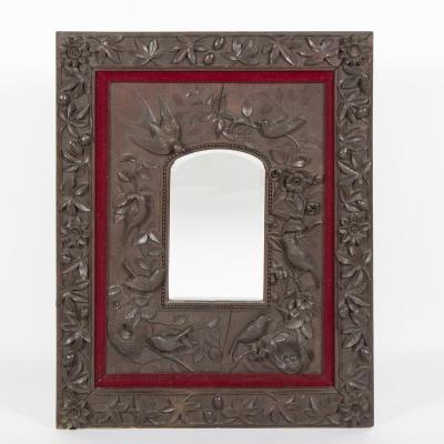Miroir aux oiseaux en noyer sculpté, XIXe