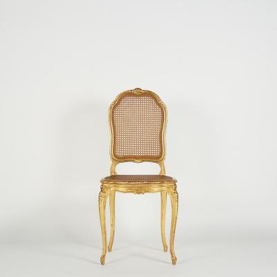 Chaise cannée en bois sculpté doré, XIXe