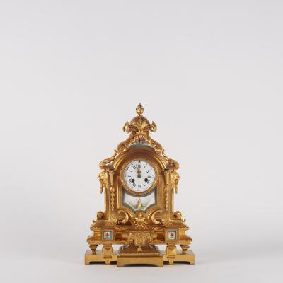 Pendule en bronze doré et plaque de porcelaine, XIXe