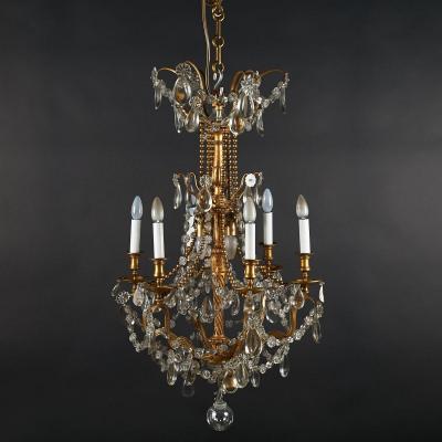 Lustre cage aux perles  en bronze doré à pampilles de style Louis XVI, XIXe