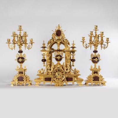 Garniture de cheminée aux Sphinges et Putti en bronze doré et marbre rouge griotte, XIXe